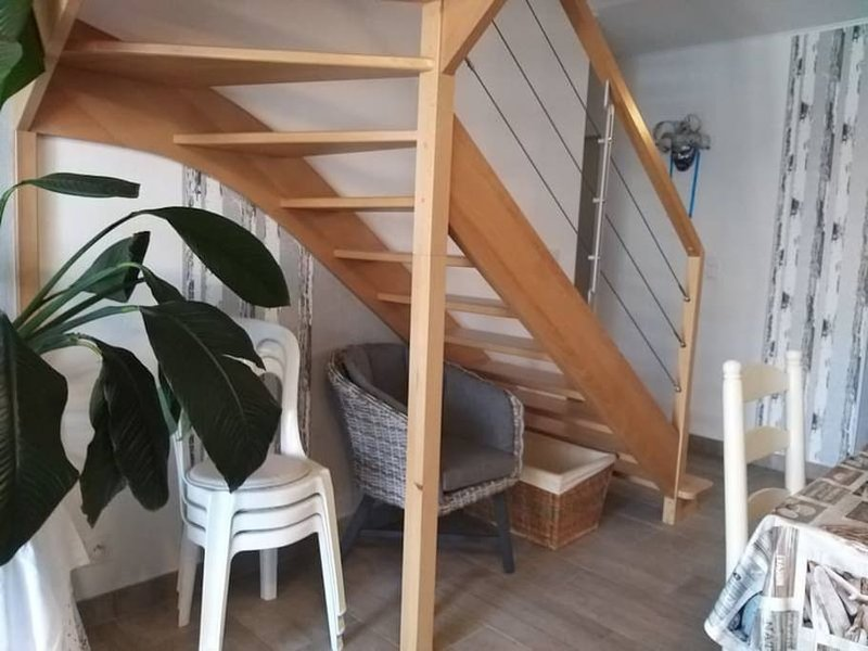 stairs up to bedrooms 2 and 3. Also a library desk, books available