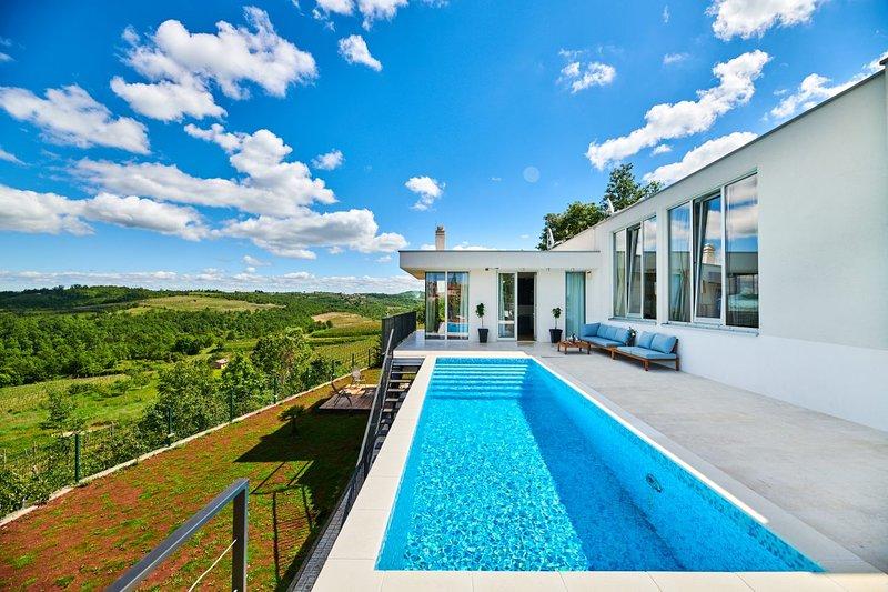 Villa Caitlan, alquiler de vacaciones en Momjan