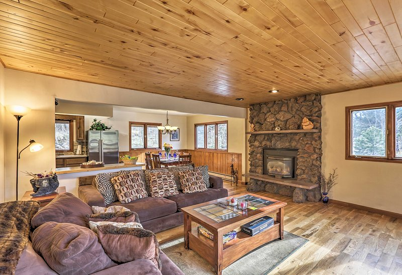 Settle in for a mountain getaway at this rustic-yet-cozy Black Hawk home!