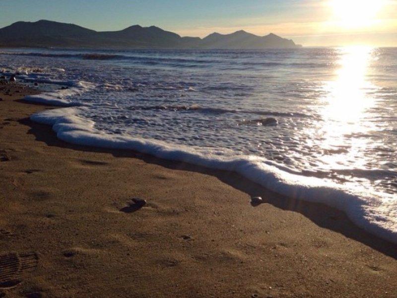 Take a dusk stroll along the beach