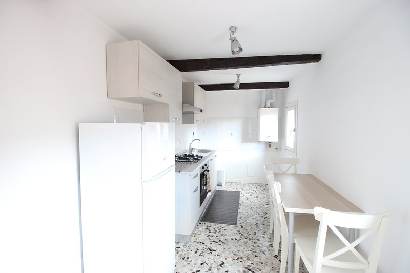 completely new kitchen with stove, oven, kettle, fridge and everything you need to prepare food