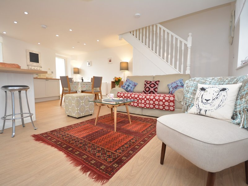 Contemporary open-plan living in this superb coastal cottage