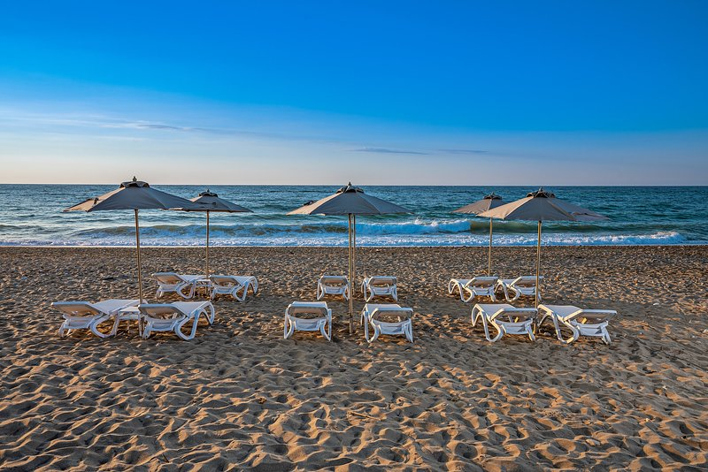 Private sun beds at the sandy beach of Rethymno, just 70 meters