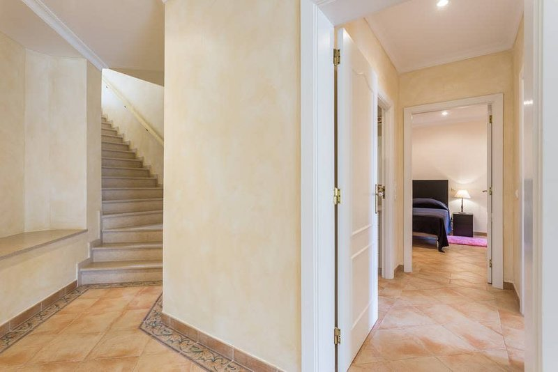 Steps leading from front door to lower level bedrooms and living dining area and terrace.