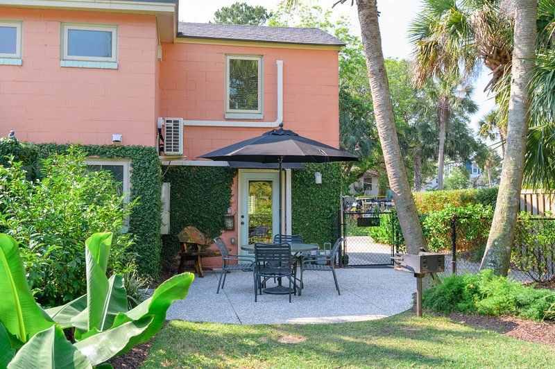 Enjoy Outdoor Living in this Completely Fenced In Backyard with Patio for Dining and Charcoal Grill