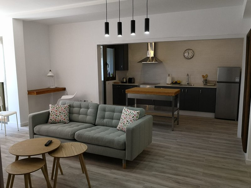 Spacious and modern spaces. Living room, dining room and open concept kitchen with study area.