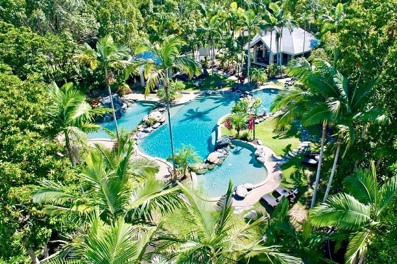 Beautiful lagoon swimming pool with waterfall.