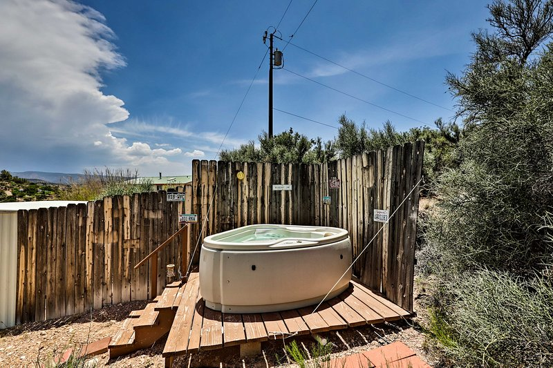 This property boasts an outdoor hot tub and mountain views!