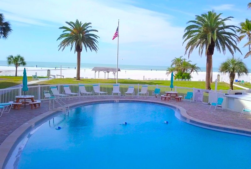 One of the three pools on property, with a view of the Gulf of Mexico!   Priceless.