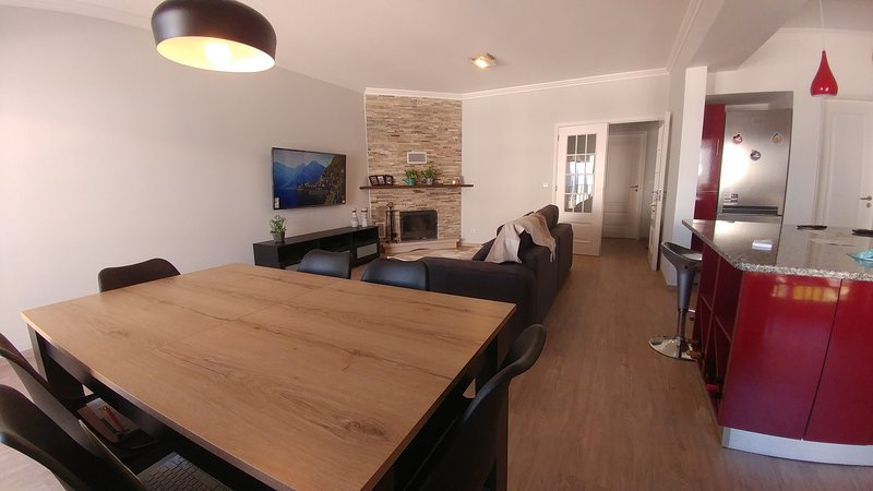 Dinner table and living room