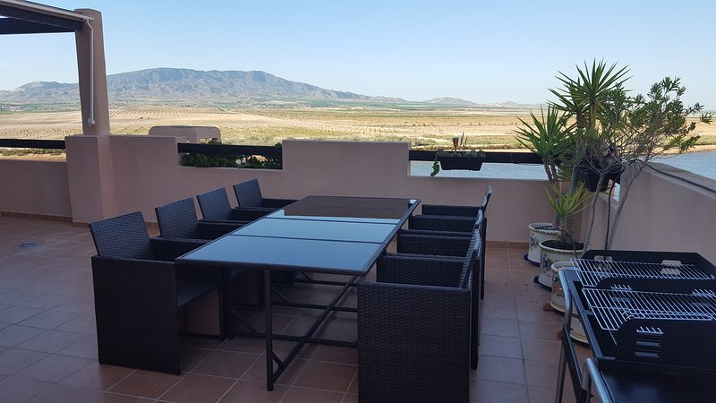 Outdoor dining on our vast sun terrace - 22 paces long front & 15 paces side. Mountain & lake views.