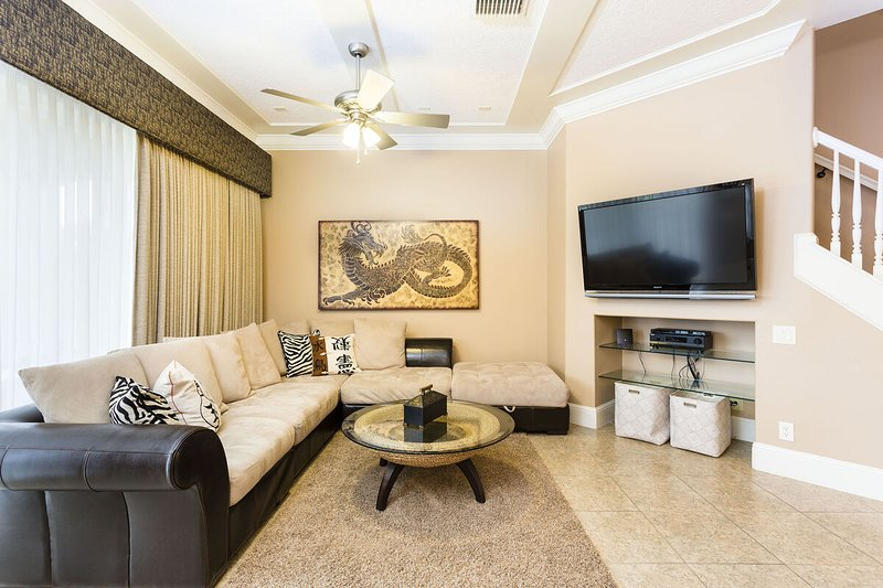 Living Area with Wrap Around Sofa and Flat Screen Television