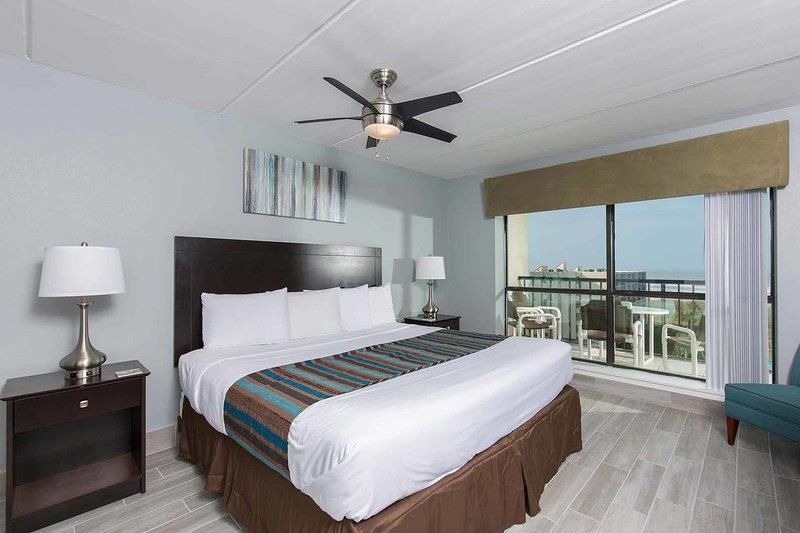 The lovely master bedroom has a king-size bed and a beautiful view!