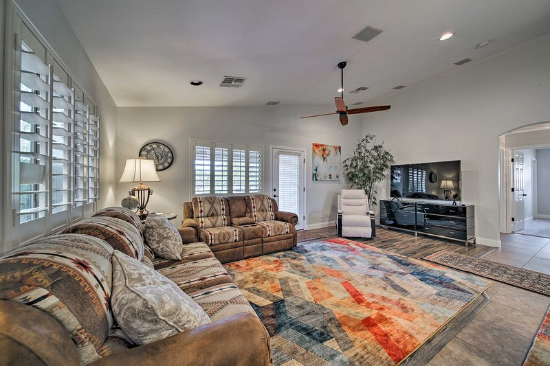 Relax at this 3-bedroom, 2-bathroom vacation rental home in Maricopa!