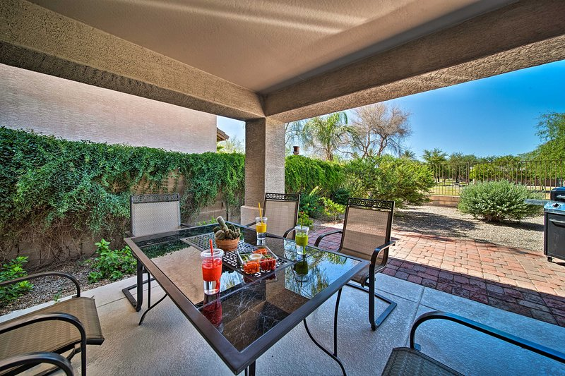 The backyard is perfect for enjoying the fabulous weather and grilling out!