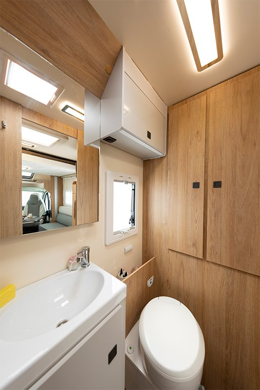 compact bathroom in 590 with shower and toilet