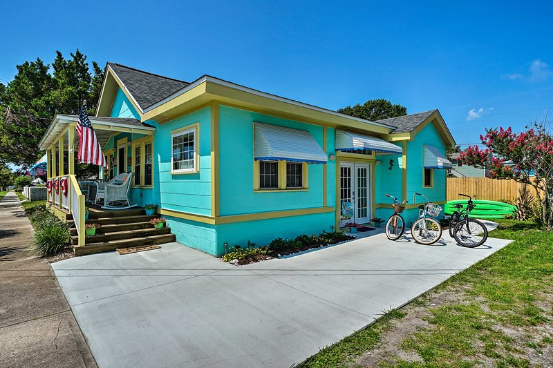 Teal and seafoam green exteriors make 'Mermaid Cottage' a perfect beach escape.