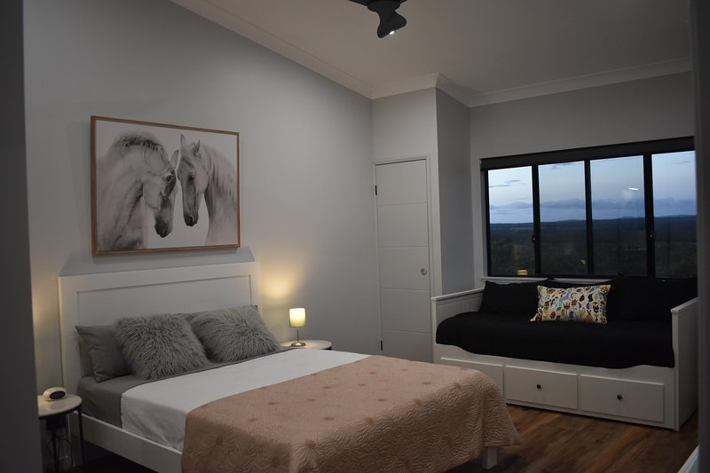 Bedroom with queen bed and daybed which opens into a king. Plus amazing views!
