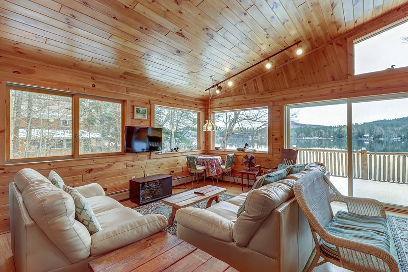 Lakefront, two-story Adirondack log cabin with dock and sandy beach, holiday rental in Brant Lake