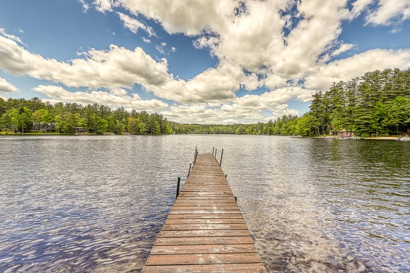 NEW LISTING! Lakefront cabin with sandy beach, dock, multiple fireplaces, holiday rental in Pottersville