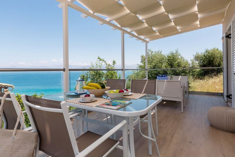 A newly built beach-front villa with stunning panoramic sea view, holiday rental in Apraos