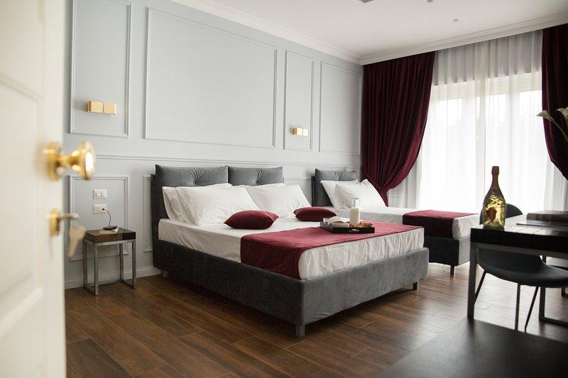 Red Suite-Unicum Roma Suites, alquiler vacacional en Il Casaletto