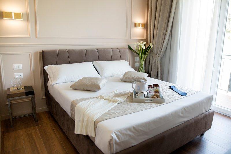 Brown Suite con Balcone - Unicum Roma Suites, alquiler vacacional en Il Casaletto