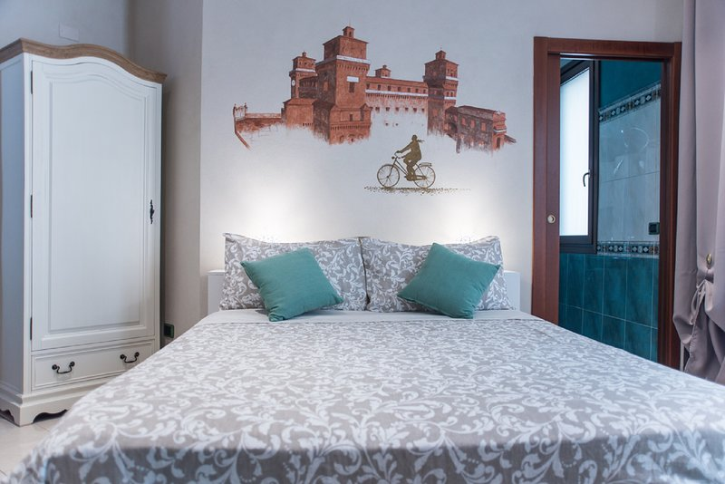 double bed with painting of the Castle behind