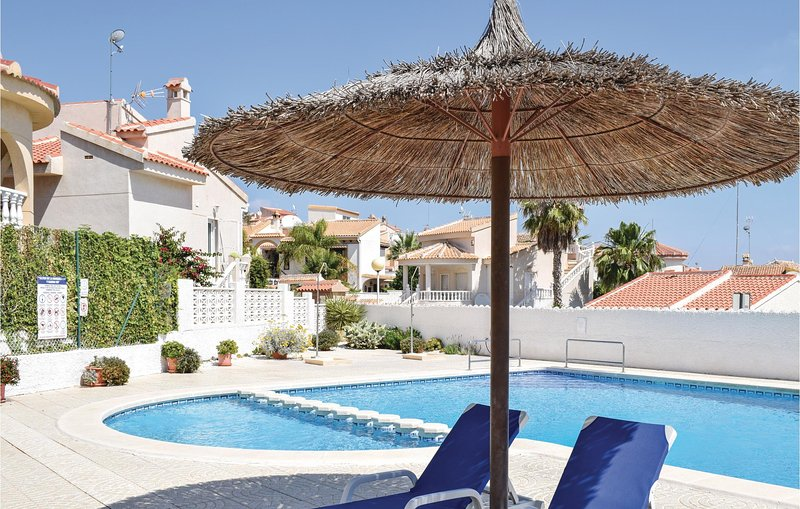 Nice home in Rojales with WiFi, Outdoor swimming pool and 2 Bedrooms (EBI211), holiday rental in Daya Vieja
