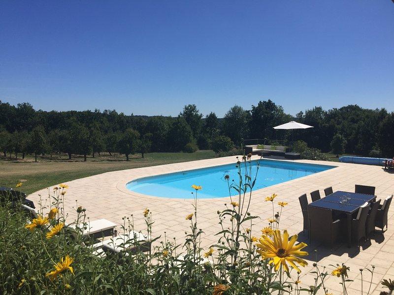 Pool overlooking orchard