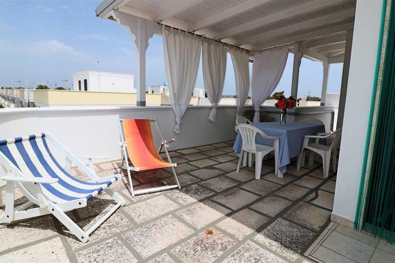 Attico Pitagora holiday home with sea view in Torre San Giovanni in Salento, location de vacances à Posto Rosso
