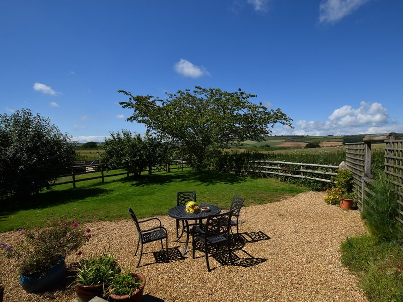 A lovely rural retreat with views over the fields beyond