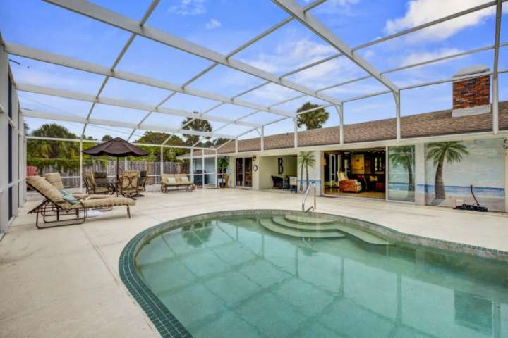 Heated optional saltwater pool with lots of room to have all your friends & family together.  A grill is located just outside the gate.