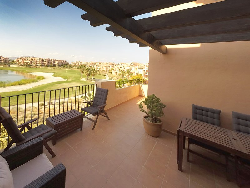 Enjoy amazing views of the golf course and lake from your private balcony