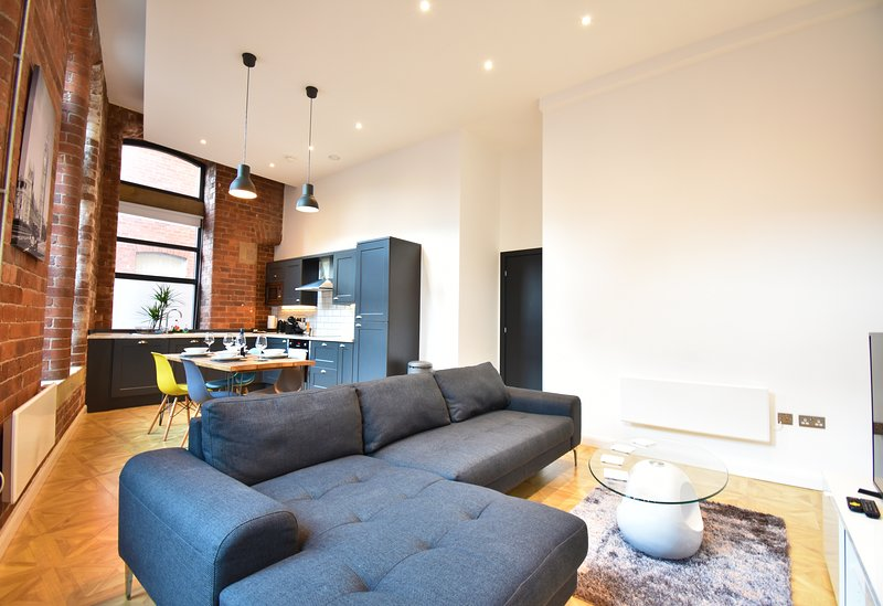 Exposed Brick with open plan Living room