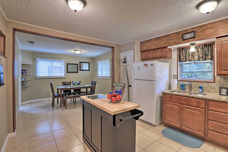 You'll love the spacious open-concept kitchen and dining area.