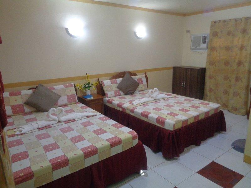 D Lucky Garden Inn Family Room 8, holiday rental in Bancao-Bancao