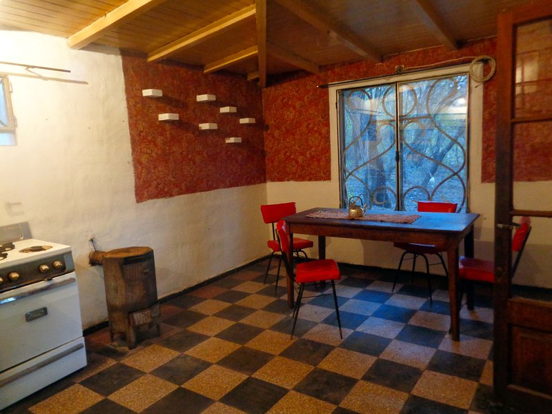 The kitchen is a shared space and offers warmth and is fully equipped