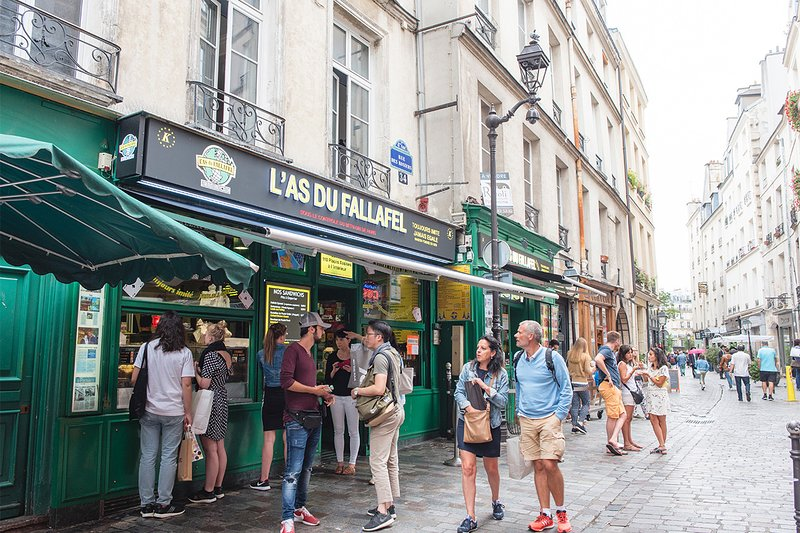 Stroll along the charming Rue des Rosiers