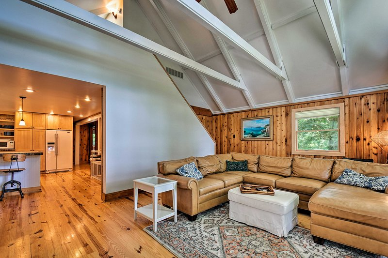 This vacation rental boasts high ceilings and ample natural light.