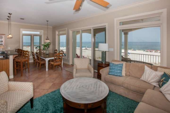 Living room w/incredible Gulf views, sectional sofa, side chair, coffee and end tables, ceiling fan and flat screen TV