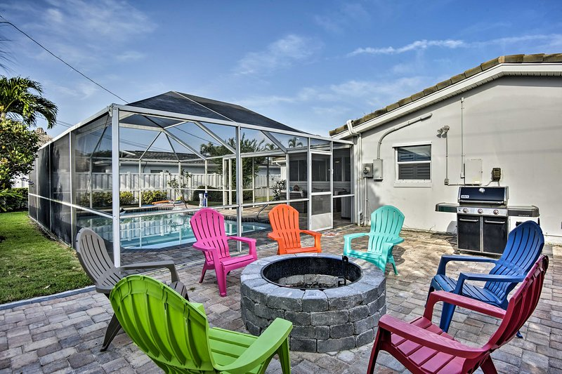 Kick off your Cocoa Beach retreat around this home's outdoor fire pit!