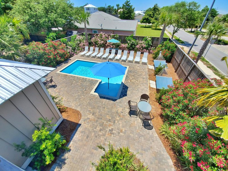 Large Back Yard. 11x22 Private Pool + 6x6 Kiddie/Tanning Shelf. 2 Hammocks. Lots of lounges! Lush Landscaping.