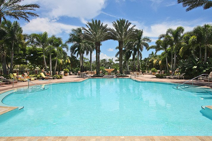 Enjoy the Florida weather on this expansive pool deck with private furnished cabanas, outdoor cooking centers, and comfortable lounge chairs