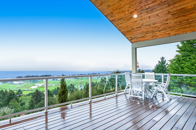 Expansive hillside home w/ amazing ocean view, decks & home theater, holiday rental in Harbor