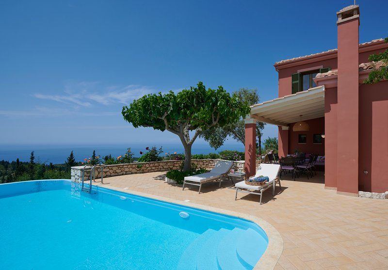 Sophisticated Luxury Villa with Private Pool, Panoramic Sea View & Dreamy Sunset, vacation rental in Kavallos