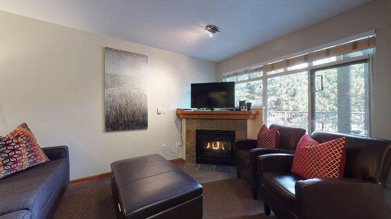 Cozy living room complete with a gas fireplace for a relaxing ambiance