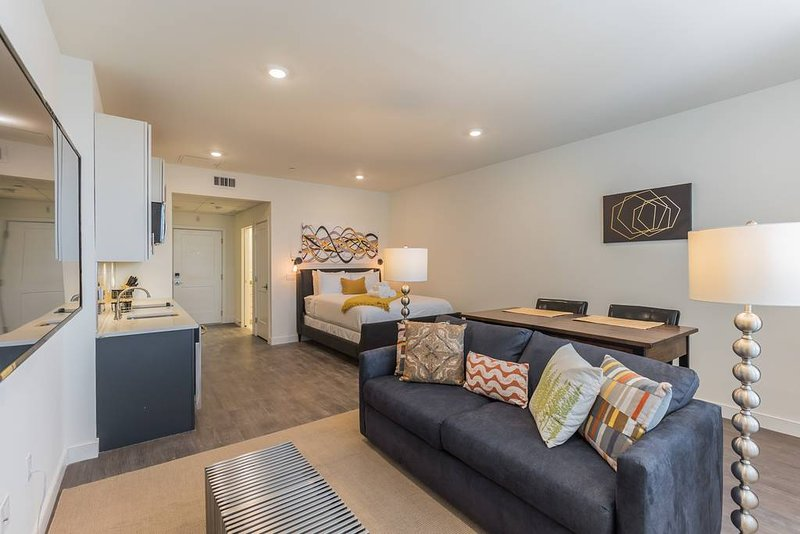 Featuring a large single open floor plan approx 250% larger than the size of your average hotel room with Queen Sized Upholstered Bed with superior linens, fluffy towels, dining table, laptop friendly surface, sleeper sofa, 50' Streaming Flat Screen ...