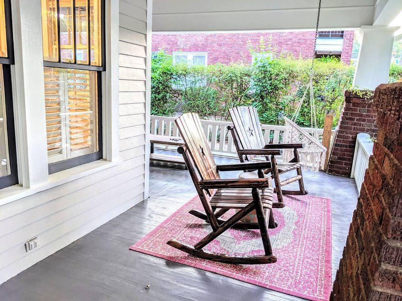 Enjoy the wonderful front porch with fans, a swing, and rocking chairs :)