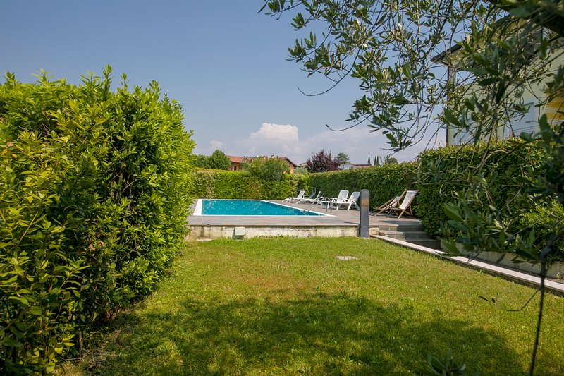 Small garden area provides access to the pool